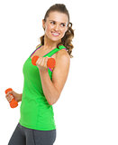 Happy fitness young woman making exercise with dumbbells and loo