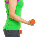 Closeup on fitness young woman making exercise with dumbbells