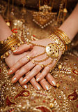 Hands of a bride in a traditional wedding jewelry. Sri Lanka