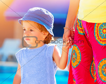 Little boy with mom outdoors