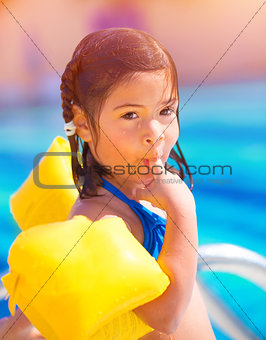 Small girl in poolside