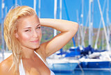 Beautiful woman in sailboat harbor