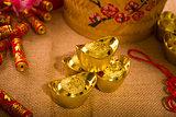 Chinese new year with decoration, large gold ingot and mandarin