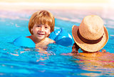 Little boy with mom in the pool