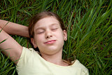Girl lying on a meadow in nature