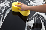 Washing a car with a lot of foam