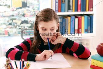 Little girl doing her school homework