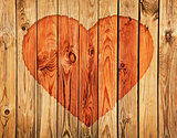 Silhouette of heart on wooden wall