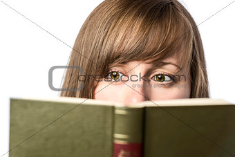 Pretty female student reads a book