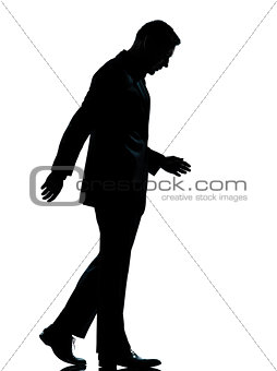 one business man walking looking down silhouette