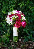 bridal bouquet made of peonies and freesia