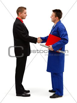 Business man shaking hands with engineer