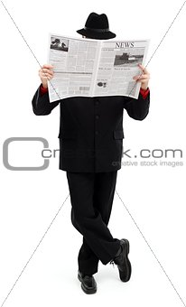 Man in black covering himself with newspaper