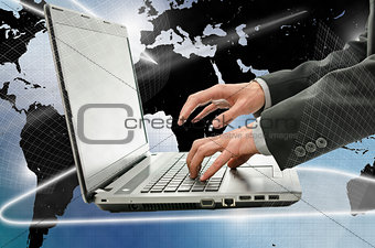 Business man using laptop in interactive space