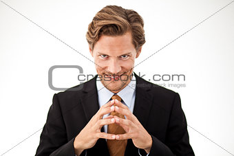 Contemplating Businessman holding fingers together in front