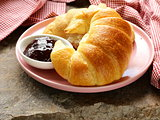 Fresh French croissant with jam for breakfast