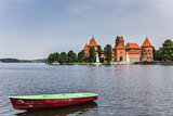 Trakai red brick castle with a boat in front