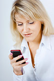 portrait of blonde girl with mobile phone