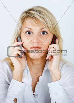 blonde girl with two mobile phones