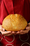 loaf of homemade bread in the chef hands