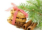 Christmas cookies with red ribbon and green fir tree  branches