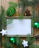 Christmas green fir tree  branches with beautiful decorations on wooden background