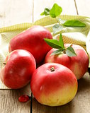 fresh ripe red apples on a wooden table