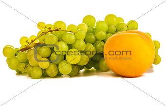 green grapes and ripe peach