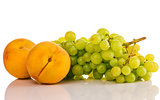 green grapes and ripe peach