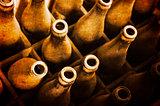 Old dusty beer bottles in wooden case