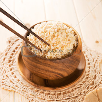 Eating rice with chopsticks.
