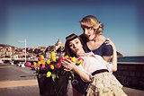 vintage funny fashion women with flowers near the sea