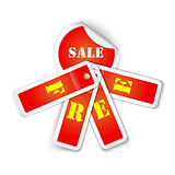 Sale sticker with attached labels and with letters FREE