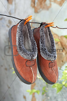 Slippers hanging on a wire
