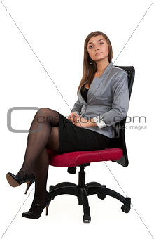 Business woman sitting in a chair