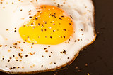 fried peppered egg in pan
