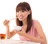 Asian woman eat rice