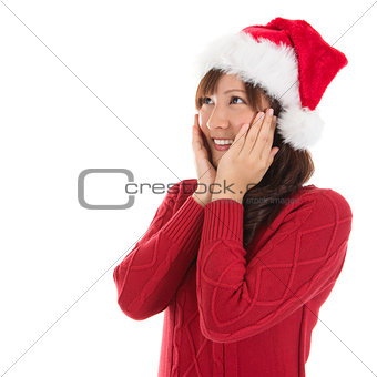 Daydreaming Asian Christmas woman