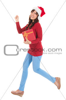 Christmas woman running with gift