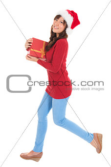 Christmas woman running with gift box