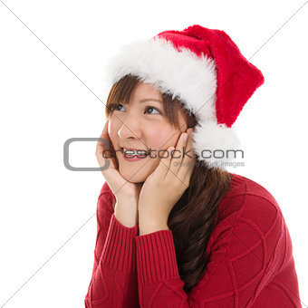 Thoughtful Asian Christmas woman