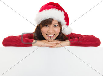 Christmas santa woman showing blank billboard sign.