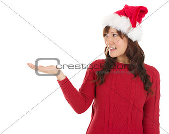 Christmas girl showing empty palm