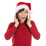 Shocked Asian Santa woman