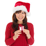 Santa hat Christmas woman holding Christmas gift