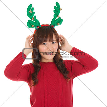 Asian Christmas woman wearing reindeer horns.