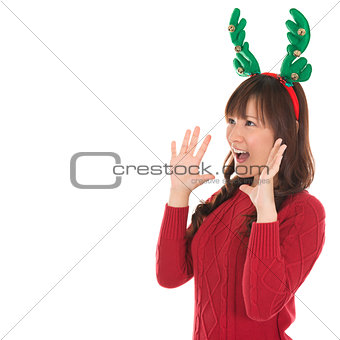 Happy Asian Santa woman shouting