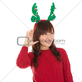 Young Asian Christmas Girl listening