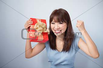 Happy Asian Girl Holding Gift Box