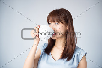 Asian woman drinking a cup of coffee
